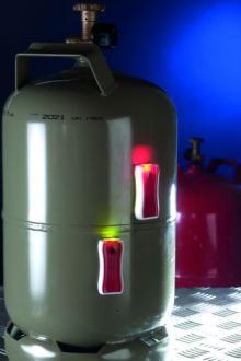Gaslevel monterad på en gasolflaska