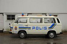 VW Caravelle 1988 uppställd vid Polishögskolan i Solna.