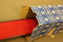 En reflexramp i nyskick med texten Coupé tittar fram ur originalkartongen. Magi!