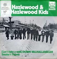 Lee Hazlewoods singel Walk down Valhallavägen. Lee strosar  med sin lilla kör Hazlewood Kids 1972. Och är det förresten inte Fältöversten som håller på att byggas just där i bakgrunden? Gallerian invigdes 1973, så det kan mycket väl vara exakt samma plats.