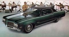 Med Oldsmobile på kontoret 1970
