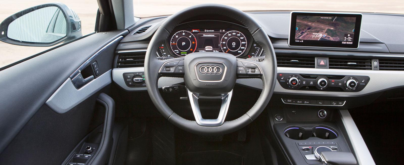 Oförskämt hög detaljfinish i Audin. Framstolarna är bra, men sittkomforten störs av att armstöden i dörrsidorna sitter för lågt.