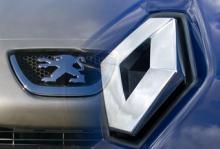 Arbetare hotar spränga bilfabrik