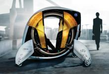 """<p><b>General Motors - The Car Hero:</b><br/> Föraren knappar in sin destination i mobiltelefonen och därefter tar bilen over kontrollen. Nu kan föraren försöka slå systemets färdigheter och när man blir duktigare låser bilen upp mer och mer av kontrollen av fordonet.<br /><br />Datorspel möter bilkörning, tråkiga transportsträckor ska vara ett minne blott.<br /><br />Dessutom kan bilen forma om sig för att skapa nya utmaningar. Bland annat ska hjulkonfiguration kunna förändras från fyra hjul till den """"ultimata utmaningen"""" - ett hjul.</p>"""