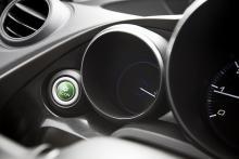 Den gröna knappen ställer om motorn för lägsta bränsleförbrukning.