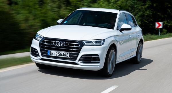 En enda detalj avslöjar laddhybridsversionen av Audi Q5 – laddluckan vid vänster bakhjul.